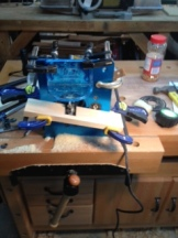 Front view showing router lift mounted vertically in my bench vise.