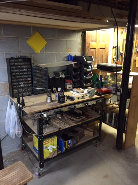 Screws, nuts, bolts, charging station, pencil sharpener, coffee maker, power strip, shop towels, and general catch all. Everyone has a place like this.