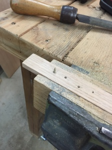 Screw into hardwood and clamped in a vise.