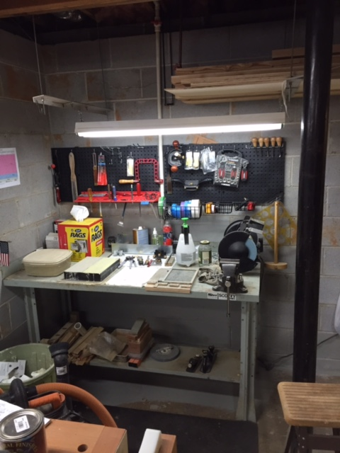 This is my sharpening station. Using Norton waterstones, flattening with sandpaper on a granite block. Use a Veritas Mk II jig and a strop. Recently added a DMT EE for carving chisels.